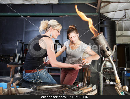 Workers Cleaning Hot Tools stock photo, Two glass artists at workbench cleaning tools by Scott Griessel