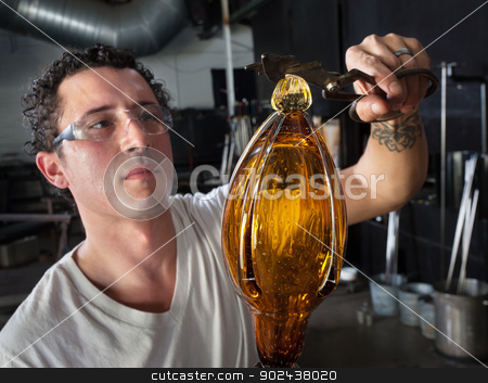 European Glass Art Student Working stock photo, Handsome European glass art student finishing vase by Scott Griessel