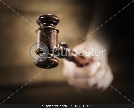 Gavel stock photo, A high quality mahogany wooden gavel. Very short depth-of-field. by Stocksnapper