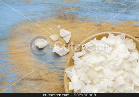 shredded coconut flakes stock photo, flakes of shredded coconut in a small ceramic bowls against  grunge wooden background, copy space by Marek Uliasz