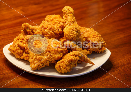 Fried Chicken on Square White Plate stock photo, Fresh, fried chicken on a square white plate on a wood table by Darryl Brooks