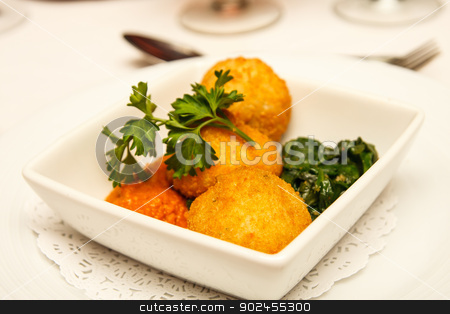 Conch Fritters and Parsley stock photo, An appetizer of conch fritters with sauce, gsarnish and parsley by Darryl Brooks