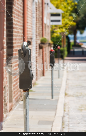 Line of Parking Meters stock photo, A line of parking meters down and old town street by Darryl Brooks
