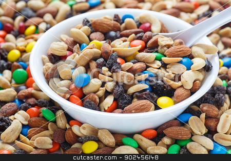 Trail Mix in White Bowl stock photo, Colorful trail mix in a white bowl with spoon by Darryl Brooks