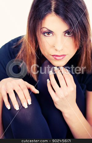 woman black dressed stock photo, Pretty woman black dressed holding hands on her knees by iMarin