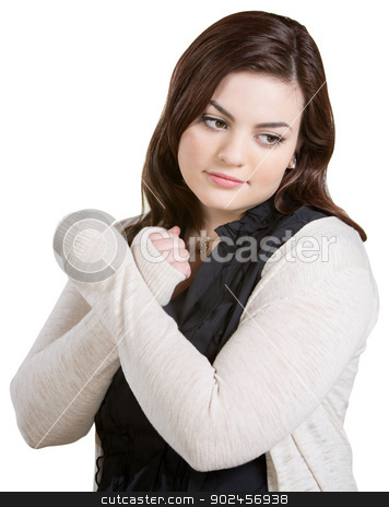 Woman Crossing Arms stock photo, Woman with arms crossed looking down on white background by Scott Griessel