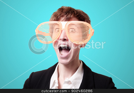 businesswoman with big funny eyeglasses screaming  stock photo, businesswoman with big funny eyeglasses screaming on blue background by Eugenio Marongiu