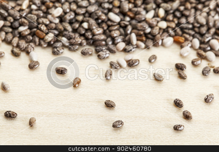 chia seeds  close-up stock photo, chia seeds  on poplar wood surface -  a close-up with a shallow depth of field by Marek Uliasz