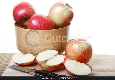 Whole and Cut Apples on Board stock photo, Apples in a wood bowl and on cutting board with some cut in half by Darryl Brooks