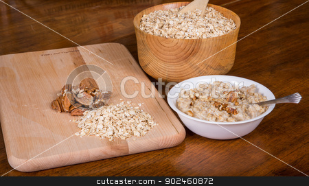 Fresh Cooked Oatmeal with Dry Oats and Nuts stock photo, Ingredients on a table to prepare a hot bowl of oatmeal by Darryl Brooks