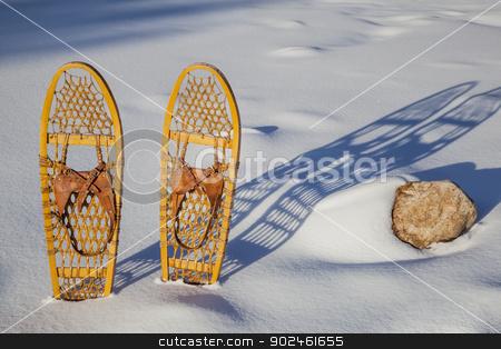 Bear Paw classic snowshoes stock photo, a pair of classic Bear Paw wooden snowshoes cast shadow in snow by Marek Uliasz