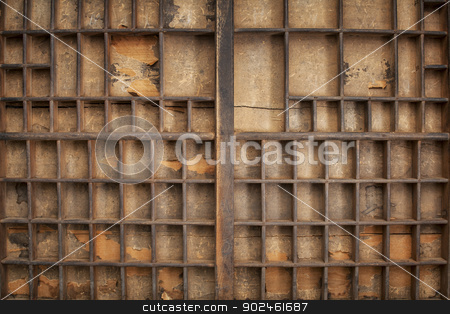 vintage typesetter drawer stock photo, grunge wood typesetter drawer with numerous dividers and decaying paper liner by Marek Uliasz