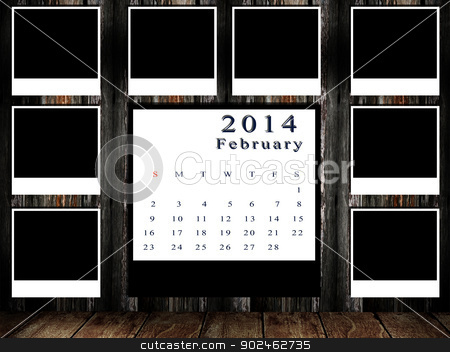 Calendar 2014 set with photo frame on grunge wall