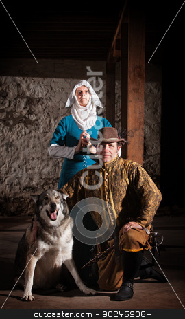 Medieval Characters with Dog stock photo, Nun behind kneeling swashbuckler and dog in medieval character by Scott Griessel