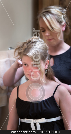 Woman Helps Girl with Hair stock photo, Adult female helping girl in dress with her hair by Scott Griessel