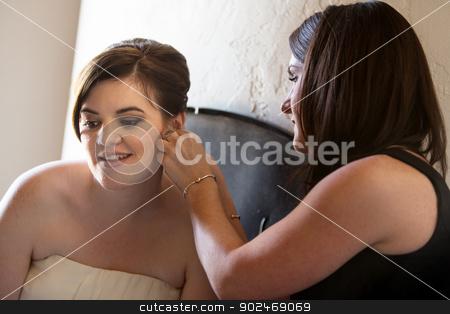 Woman Helping Bride with Earrings stock photo, Pretty European bride getting help with earrings by Scott Griessel