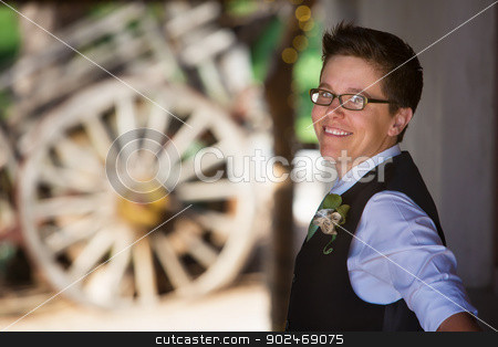 Cute Lesbian Groom stock photo, Handsome lesbian groom outdoors in vest by Scott Griessel