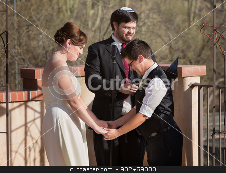 Lesbian Marriage Ceremony stock photo, Homosexual couple holding hands with rabbi officiating by Scott Griessel