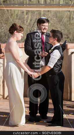 Gay Couple Marrying stock photo, Couple standing and holding hands for wedding ceremony by Scott Griessel