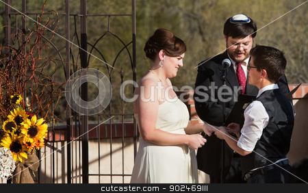 Happy Couple in Civil Union stock photo, Happy lesbian couple with rabbi in civil union ceremony by Scott Griessel