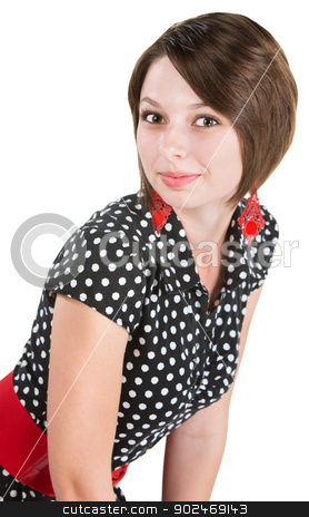 Pretty Woman Leaning Forward stock photo, Beautiful young woman in polka dot dress leaning over by Scott Griessel
