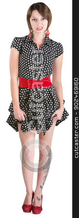 Disgusted Young Woman stock photo, Disgusted young woman holding her polka dot dress by Scott Griessel