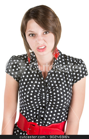 Offended Young Lady stock photo, Offended European woman in polka dot dress by Scott Griessel