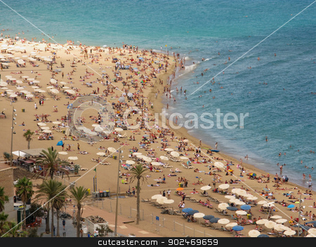 city beach of barcelona  stock photo, crowded city beach of barcelona seen from the port vell aerial tramway by Andreas Altenburger