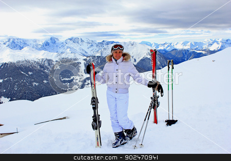 Girl on the snow in mountains stock photo, Girl with alpine ski is standing on a snow in mountains  by Dmelnikau