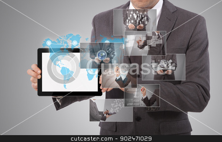 holding a tablet stock photo, business man holding a tablet, grey background by matteo bragaglio
