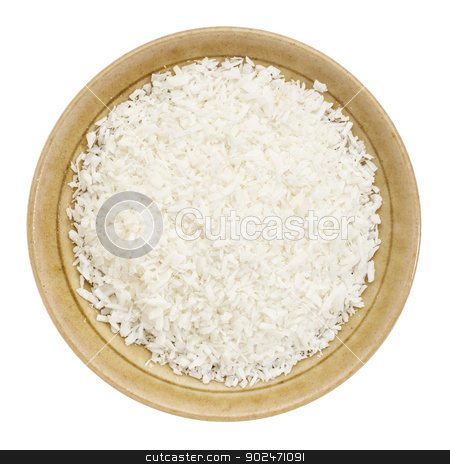 shredded coconut flakes stock photo, shredded coconut flakes in a small ceramic bowl isolated on white, top view by Marek Uliasz