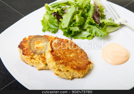 Crab Cakes and Salad stock photo, Fresh crab cakes on a white plate with sauce and a salad of field greens by Darryl Brooks