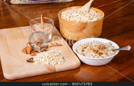 Oatmeal with Pecans and Cinnamon stock photo, Ingredients on a table to prepare a hot bowl of oatmeal by Darryl Brooks