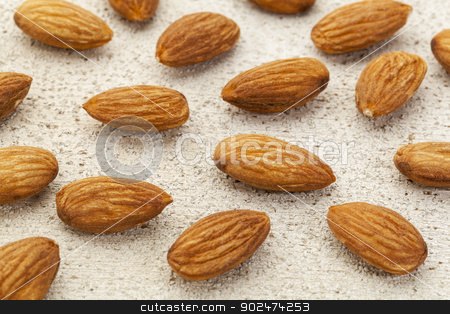 raw almonds on white wood stock photo, raw almonds spread over on  a white painted rough wood barn surface by Marek Uliasz