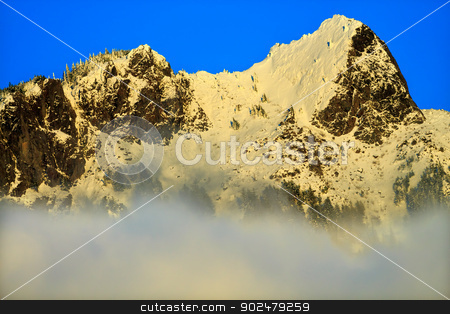 Mount Si Rising from Clouds in the Snow North Bend Washington St stock photo, Mount Si Rising from Clouds in Snow North Bend Washington State Pacific Northwest by William Perry