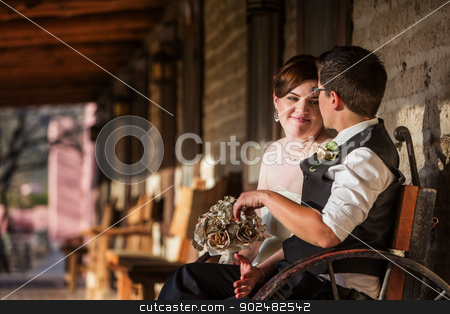 Adorable Couple Sitting Together stock photo, Adorable loving lesbian couple sitting on bench by Scott Griessel