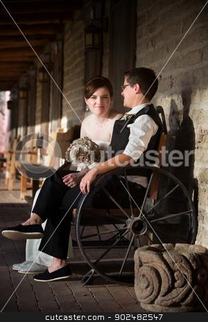 Newlyweds in Rustic Scene stock photo, Lesbian newlyweds sitting together in rustic setting by Scott Griessel