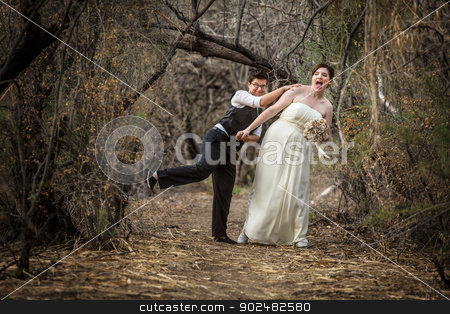 Newlyweds Playing in Forest stock photo, Bride and groom playing together in forest by Scott Griessel