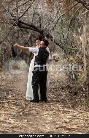 Couple Dancing in Forest stock photo, Happy European Lesbian couple dancing in forest by Scott Griessel