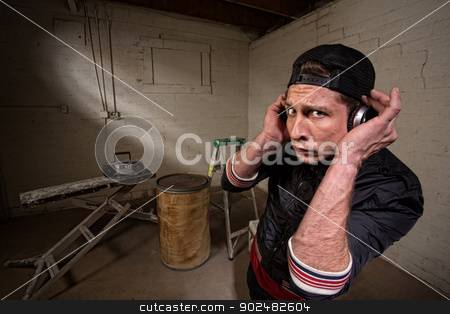 Cool Hip Hop Artist stock photo, European hip hop guy with backwards cap and earphones by Scott Griessel