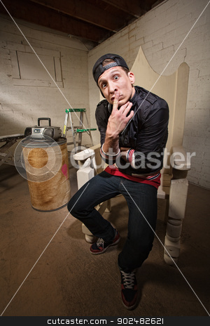 Urban Adult Thinking stock photo, Naive young urban adult in throne with finger on lips by Scott Griessel