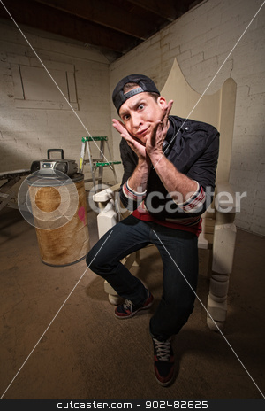 Silly Man with Hands on Chin stock photo, Silly adult sitting on throne with chin in hands by Scott Griessel