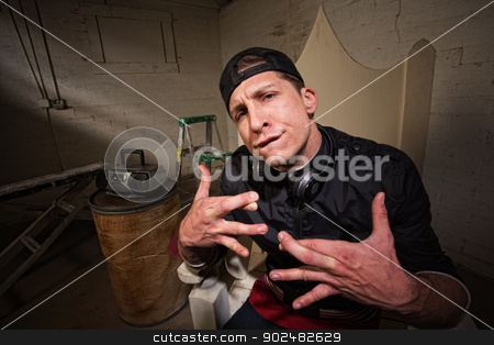 Silly Man with Crossed Fingers stock photo, Urban musician with crossed fingers and goofy expression by Scott Griessel