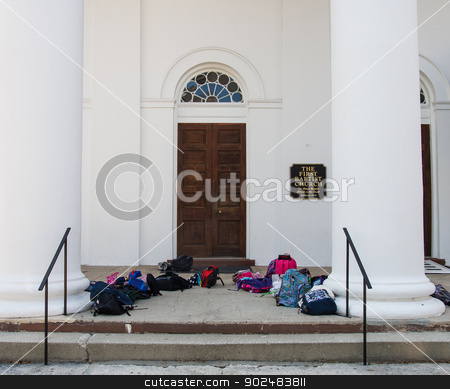 First Baptist Church with Bags stock photo, Entrance to Old Baptist Church with Children's backpacks and book bags by Darryl Brooks