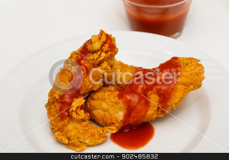 Chicken Wing with Hot Sauce stock photo, Fried chicken wing with hot sauce on white plate by Darryl Brooks