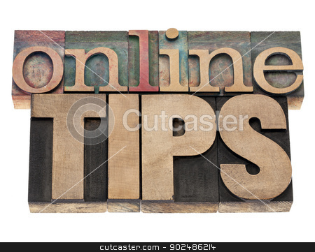 online tips stock photo, online tips - internet help concept - isolated text in vintage letterpress wood type printing blocks by Marek Uliasz