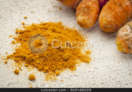 turmeric powder  and root stock photo, turmeric powder and root on a white painted rough barn wood surface by Marek Uliasz