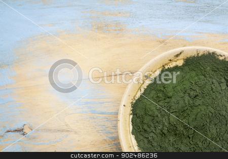 Hawaiian spirulina powder stock photo, small bowl of Hawaiian spirulina powder against wood background by Marek Uliasz