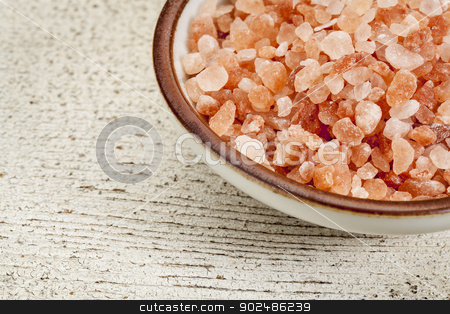 Himalayan salt bowl stock photo, Himalayan salt coarse crystals in a ceramic bowl on  a rough white painted barn wood by Marek Uliasz