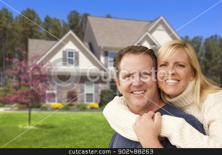 Happy Couple Hugging in Front of House stock photo, Happy Couple Hugging in Front of Beautiful House. by Andy Dean